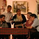 five actors around a table