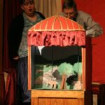 toy theatre with two actors