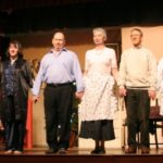 group of actors taking a bow