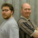 two actors posing
