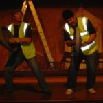 two actors playing dustbin lid