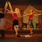 three actors dancing