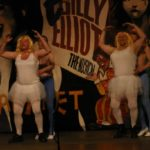 four actors, two men as ballerinas
